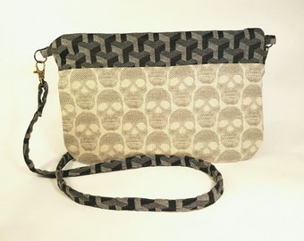 Clutch hand bag in patterned skull, black and grey cotton