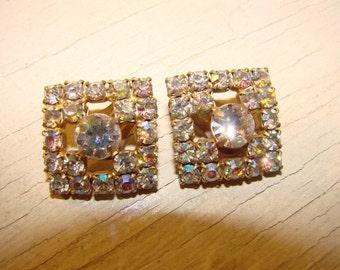 AB clip on earrings.  Mid century classic aurora borealis prong set  rhinestone earrings.  Wonderful for a bride.
