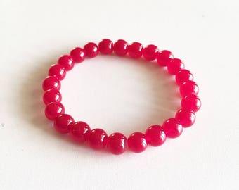 Bracelet perles en verre rouge transparentes