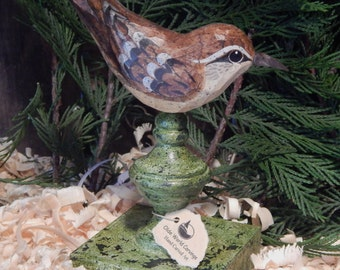 Hand Carved Bird Carolina Wren carved from White Pine.  Perched on antiqued finial.