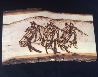 Rustic Pyrography of Three Horses