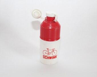 Vintage Schwinn glass water bottle with holder