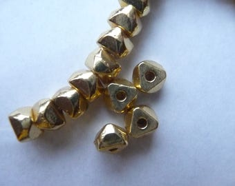 Bead, brass,bright polished finish, 6x4mm nugget. Pack of 12 beads.
