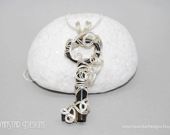 Little silver skeleton key pendant, wire wrapped with silver enamelled copper wire