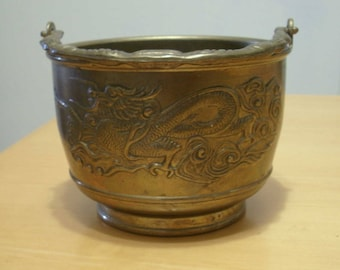 Solid brass dragon design bowl with handle