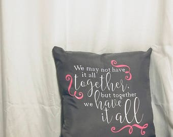 Gray pillow cover with quote.