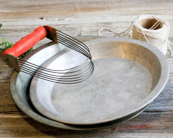 Two Vintage Pie Pans, with Pastry Cutter