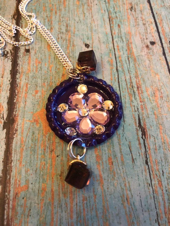 Flower bottle cap necklace with Swarovski crystals and charms