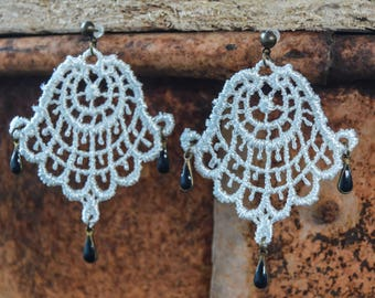 White lace and blue Eastern-inspired charm earring