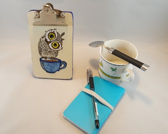 Small owl standing clipboard