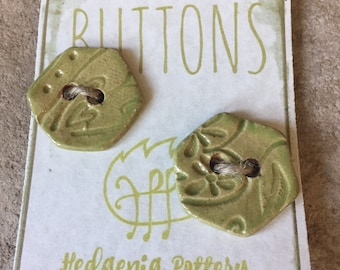 A pair of fun hand crafted wasabi green ceramic pentagon shaped buttons.