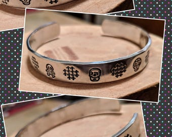 Skull Girl hand stamped and polished aluminum cuff bracelet