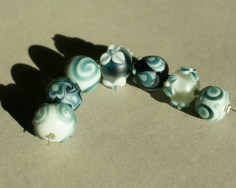 Handmade lampwork etched glass bead set by Flamejewels.