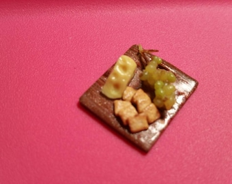 """Delicious cheese, cracker and grape platter on a cutting board. 1"""" scale dollhouse miniature"""