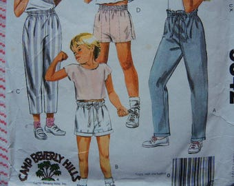 vintage 1980s McCalls sewing pattern 9542 boys' and girls' pants or shorts size medium 8-10