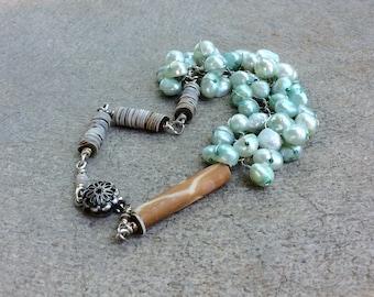 Teal Pearl chain wrapped bracelet. heishi seashells.  Feminine gift