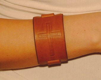 Embossed leather bracelet with a cross,