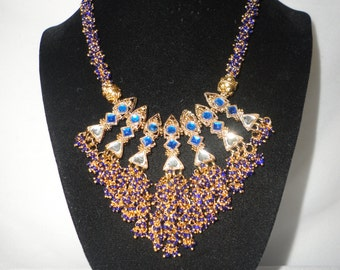 A Blue Beaded And Gold Tone Single Strand Necklace****