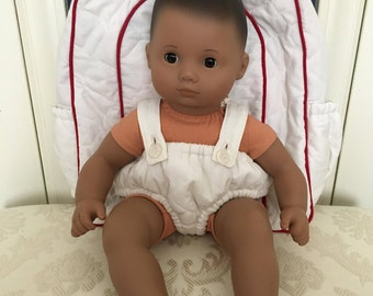 This cute diaper bag with doll carrier is handmade to use with most 15 inch baby dolls.