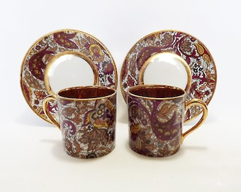 Two Paisley pattern porcelain espresso cups with gold interiors by Royal de luxe porcelaine, France