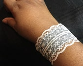 Leather and lace cuff...