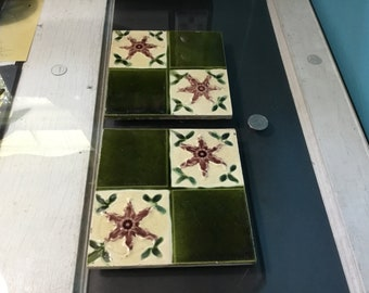 "Two 6""  ceramic tiles in green and mauve/purple. Flowers with iconic tri-leaf corners. Nibbled edges. Shabby Chic."