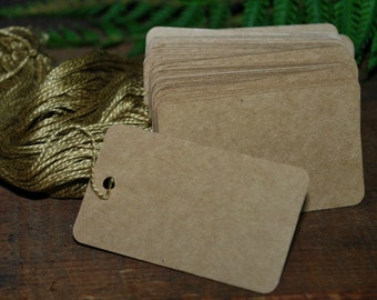 "50 Kraft Tags with Strings 2 1/2"" X 1 1/2 "" Heavy paper"
