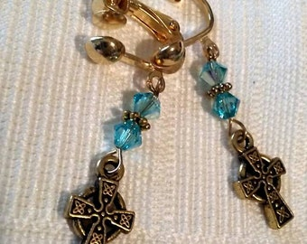 Turquoise aurora borealis Swarovski and gold plated screw back clip on earrings with Celtic Cross charms.