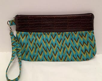 AK17- Compleat Clutch: in a modern green and brown print with pleated front, zipper closure and detatchable hand strap