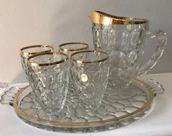 6 piece Jeannette Glass Company thumbprint glass juice set with 22 K gold rim