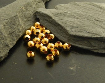 Set of 20 spacer beads, gold