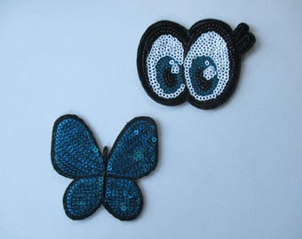 2 badges with Sequin, eyes and butterfly to customize.
