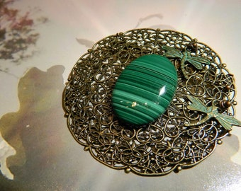Malachite on filigree brooch.