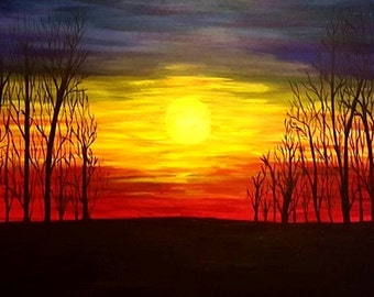sun rising among the trees
