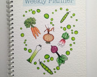 Weekly planner, undated with extra note sheets.