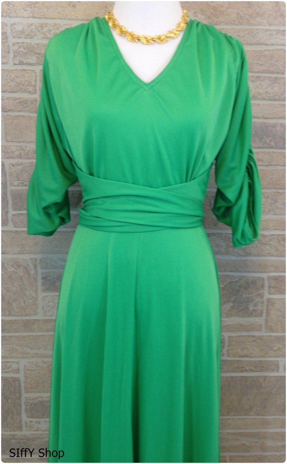 70s long green formal dress with attached sash and ruched