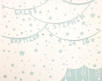 Starry Sky Personalised Papercut. A hand cut papercut featuring your details on lettered bunting on a backdrop of a starry sky.