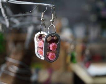 Pink earring capsule