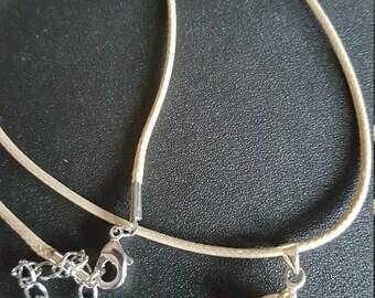Beige Gemstone pendant on a beige cord necklace