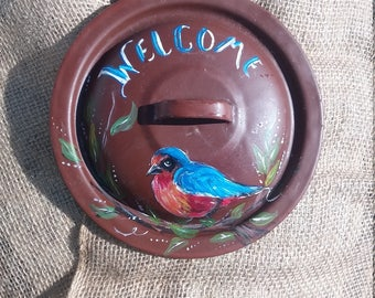 Welcome blue bird on tin lid