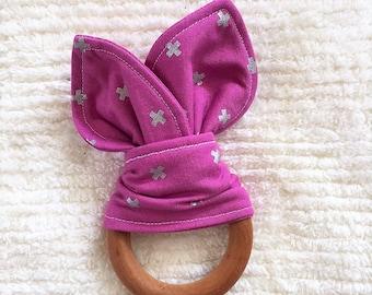 Pink swiss cross wooden teething ring