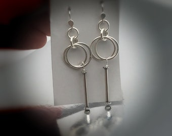 All sterling,loops and stick dangle earrings