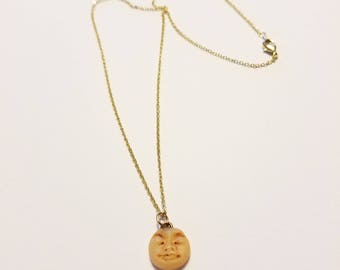 Eerie Moon Face Necklace