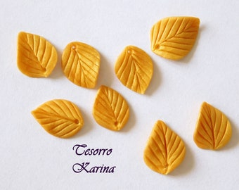 leaves of beads of polymer clay of golden color (metallic), leaves of beads for jewelry and decor, gold leaves of handwork