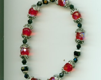 Red and Black Bracelet with Silver Accents ... Faceted beads, stretchy bracelet