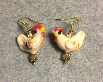 Light tan lampwork chicken bead earrings adorned with tan Czech glass beads.
