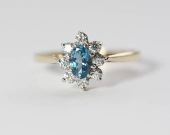 9ct Gold CZ Clear and Blue Cluster Ladies Ring with Oval Shape  UK P  and US 7.75