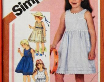Vintage little girls' dress pattern Simplicity 5950 Sleeveless sundress pattern with side button opening Uncut Size 5