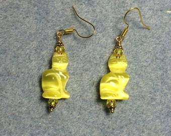 Yellow fiber optic cats eye glass cat bead earrings adorned with yellow Chinese crystal beads.
