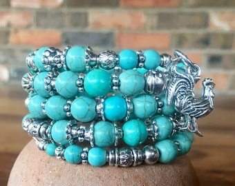 Handmade 4-wrap memory wire bracelet featuring turquoise beads with tibetan silver beads, spacers and rooster charm